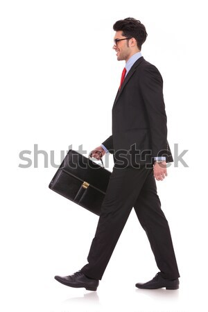man walking with briefcase & looking away Stock photo © feedough
