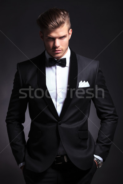 business man holds his hands in his pockets Stock photo © feedough
