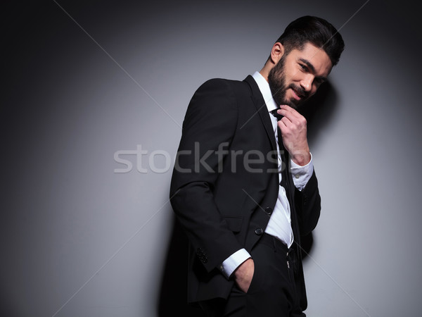 pensive young fashion man looks at you Stock photo © feedough