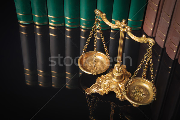 golden justice scales in front of law books  Stock photo © feedough