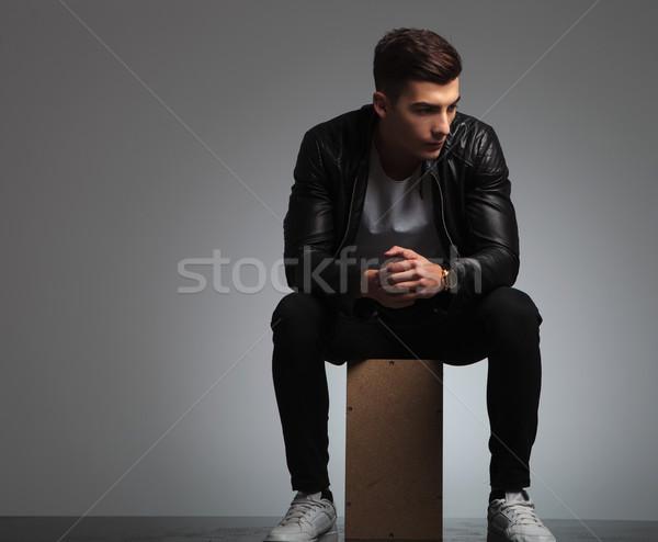 Joven negro chaqueta de cuero posando sentado estudio Foto stock © feedough