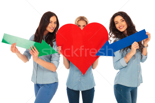 casual women are pointing their arrows to their heart Stock photo © feedough