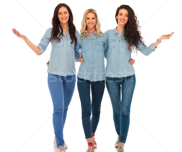 3 happy casual women walking and welcoming you Stock photo © feedough