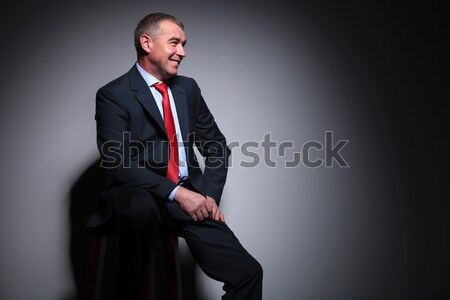 seated elegant man in tuxedo is looking up  Stock photo © feedough