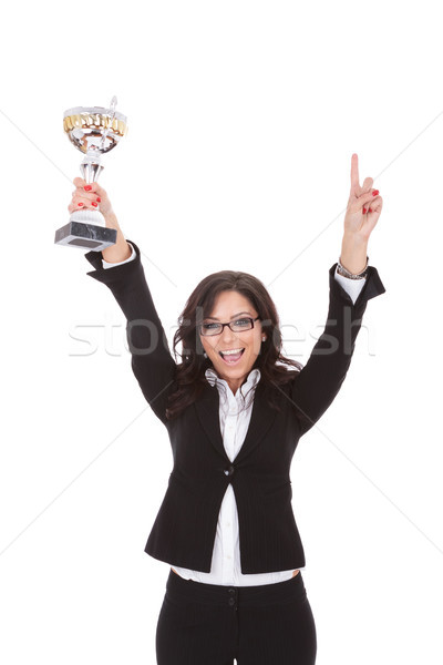 Stock photo: business woman cheers with trophy