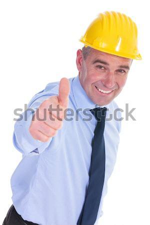 Ingeniero senalando altos mirando cámara Foto stock © feedough