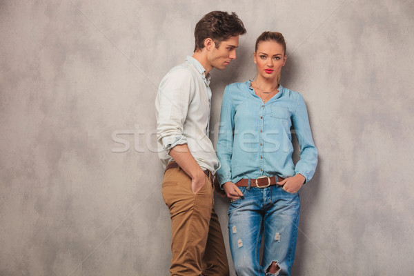 casual couple pose in studio background with hands in pockets Stock photo © feedough