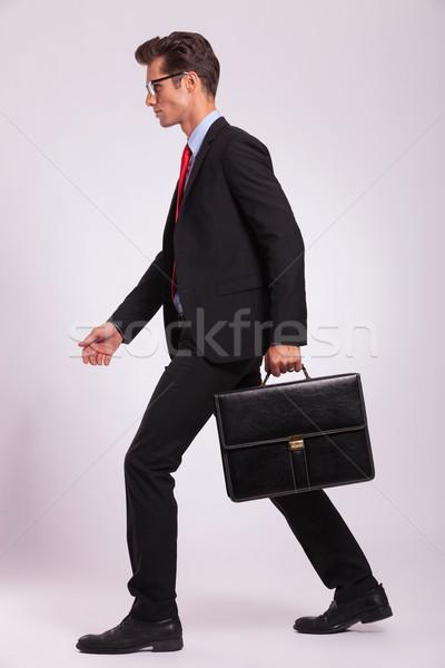 man holding briefcase & walking Stock photo © feedough