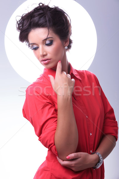 young woman looks down and touches face Stock photo © feedough