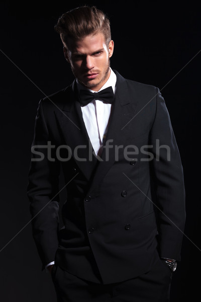 relaxed elegant young fashion man in suit Stock photo © feedough