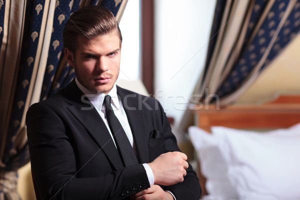 young business man fixes his cuffs Stock photo © feedough