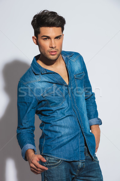seductive young casual man with hand in pocket Stock photo © feedough