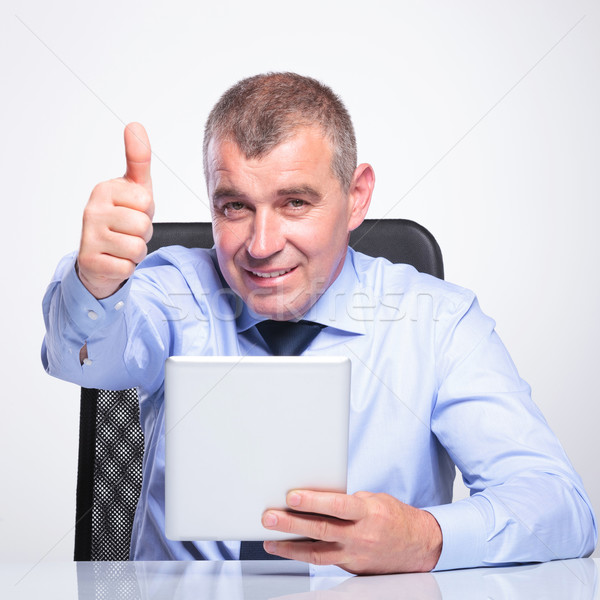 old business man with pad shows thumb up Stock photo © feedough
