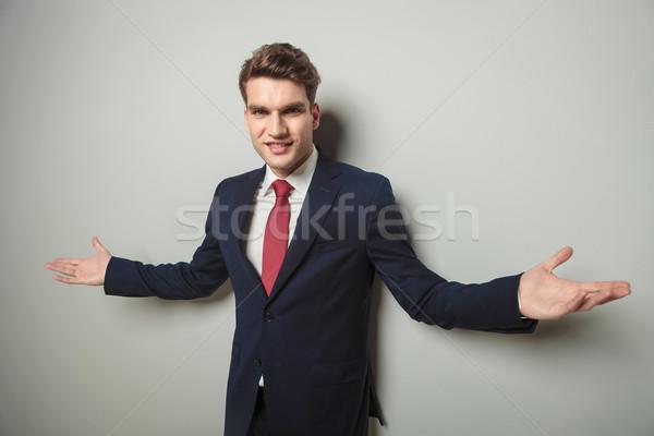 Happy young business man welcoming you Stock photo © feedough