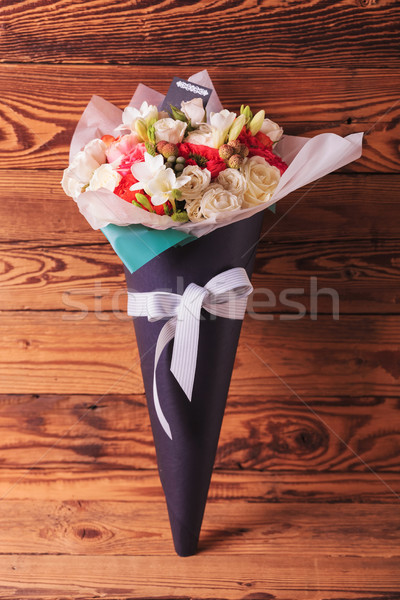 beautiful flowers arrangement in a cone with bow  Stock photo © feedough