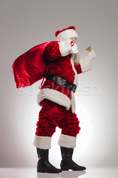 side view of santa claus ringing bell Stock photo © feedough