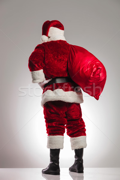 back view of santa claus with bag on shoulder Stock photo © feedough