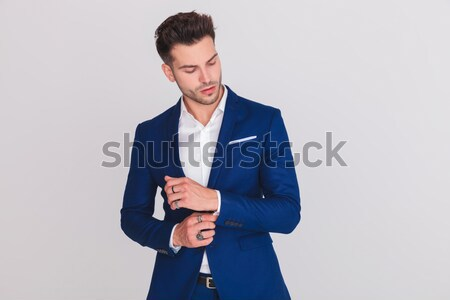 sexy smart casual man unbuttoning his blue suit jacket Stock photo © feedough