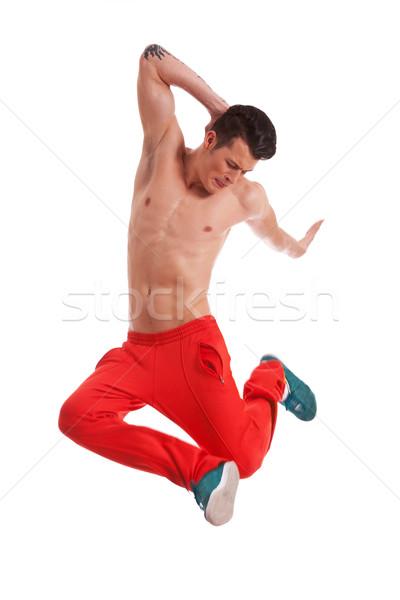 Torse nu jeunes danseur sautant style moderne posant Photo stock © feedough