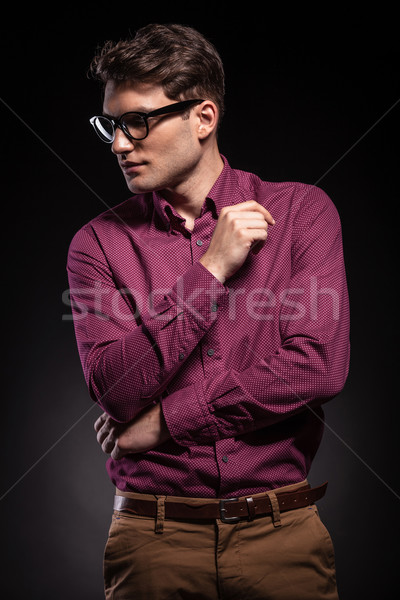 Young casual man looking down to his side. Stock photo © feedough