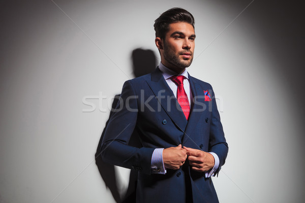 side view of a gentleman buttoning his suit Stock photo © feedough