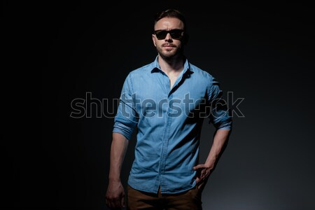portrait of confident and elegant man wearing a blue waistcoast Stock photo © feedough