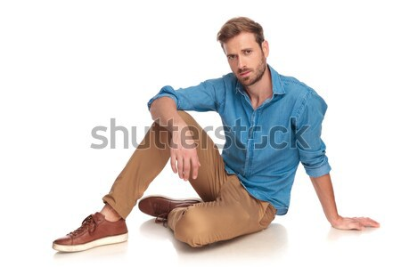 side view of a fashion man sitting down  Stock photo © feedough