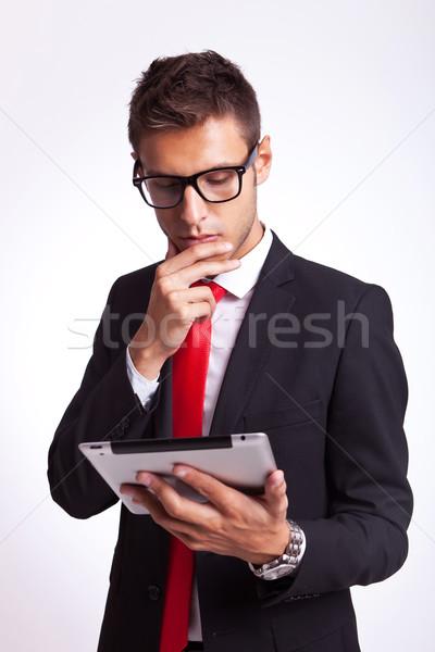 business man reaing news on his pad Stock photo © feedough