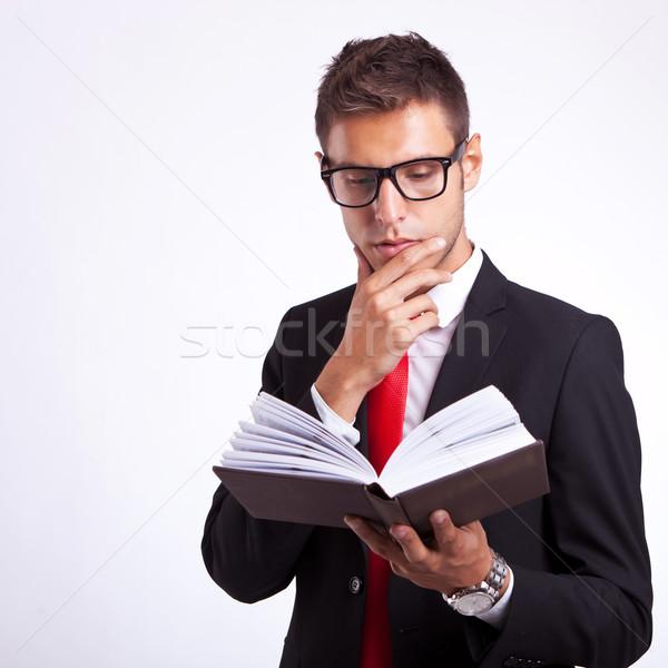 pensive business man reading a book Stock photo © feedough