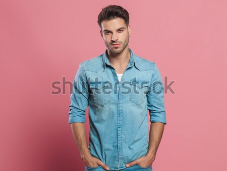 young business man facing the camera with hands in pockets Stock photo © feedough
