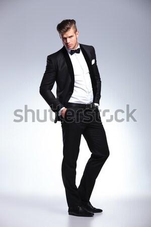 Young man in tuxedo looking down  Stock photo © feedough