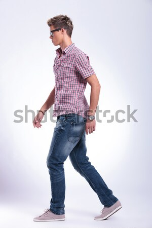 young casual man holding his hand to the forehead Stock photo © feedough