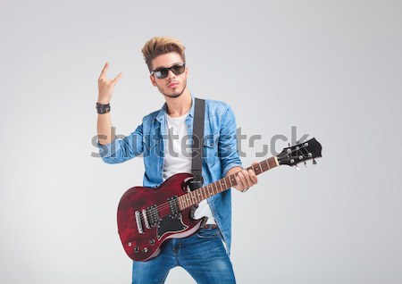 cool casual guitarist playing his red electric guitar Stock photo © feedough