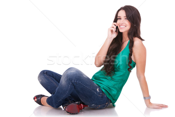 girl sitting and talking on phone Stock photo © feedough