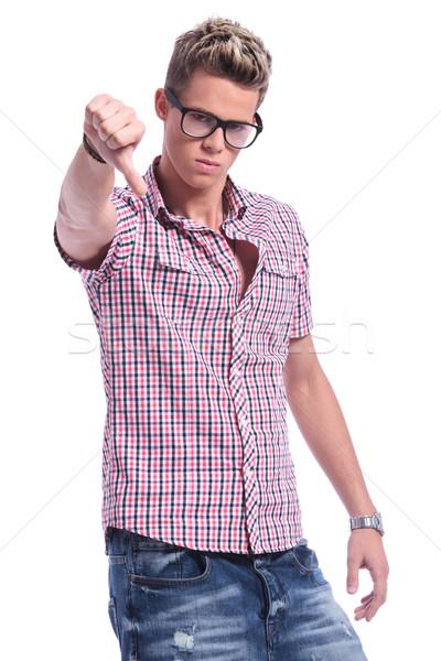 casual man thumb down Stock photo © feedough