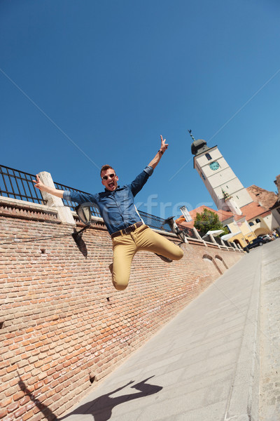 casual man jumping in Sibiu Stock photo © feedough