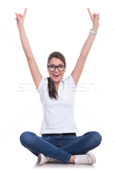 casual woman sits & cheers up Stock photo © feedough