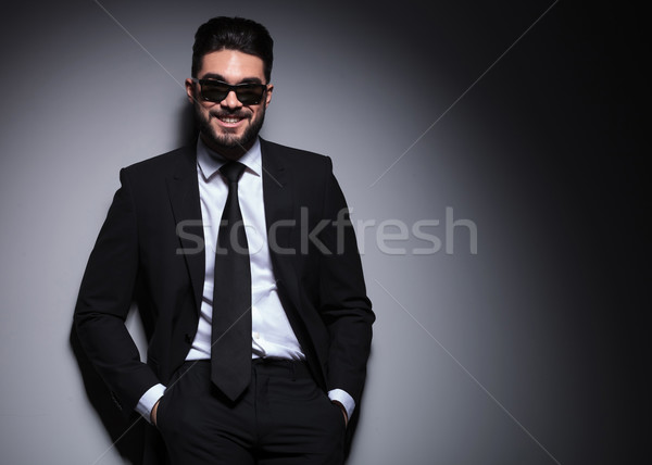 young fashion man with sunglasses smiles at you Stock photo © feedough