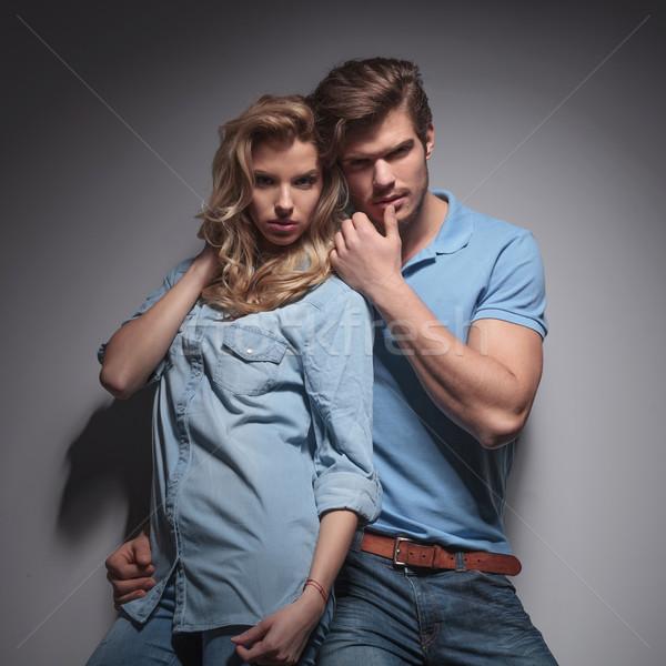 Sensual casual casal provocante pose cinza Foto stock © feedough