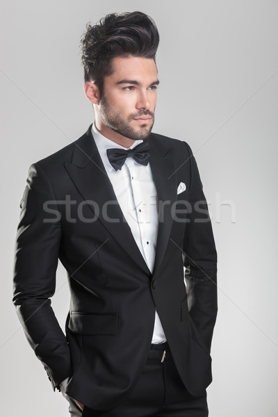 elegant young man holding his hand in pocket. Stock photo © feedough