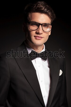 Attractive young business man offering you a invitation. Stock photo © feedough