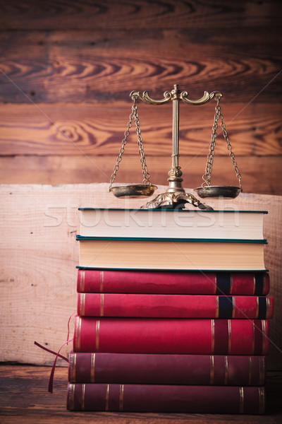 golden scale on top of stack of law books Stock photo © feedough
