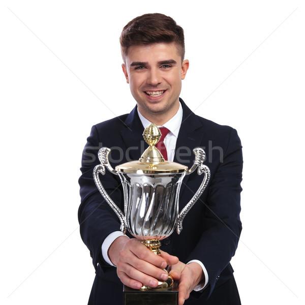 Feliz empresario ofrecimiento ganar taza retrato Foto stock © feedough