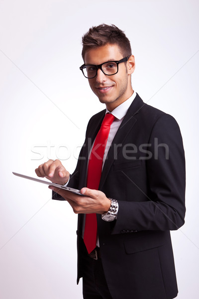 business man holding a touch screen pad Stock photo © feedough