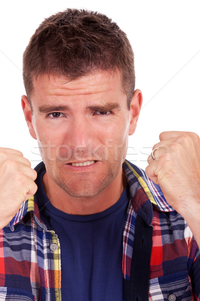 frustrated young man shows fists Stock photo © feedough