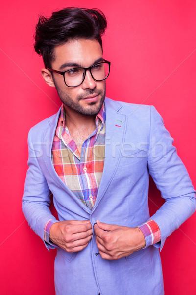 Smart casual man closing his jacket Stock photo © feedough