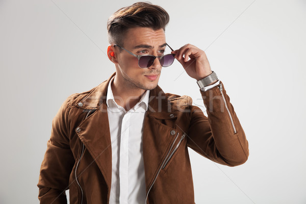 young casual man putting on his sunglasses  Stock photo © feedough