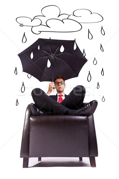 man sitting in comfortable armchair with umbrella Stock photo © feedough