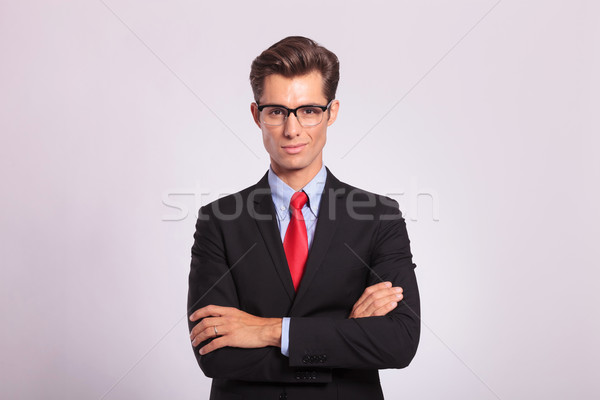 business man standing with hands folded Stock photo © feedough