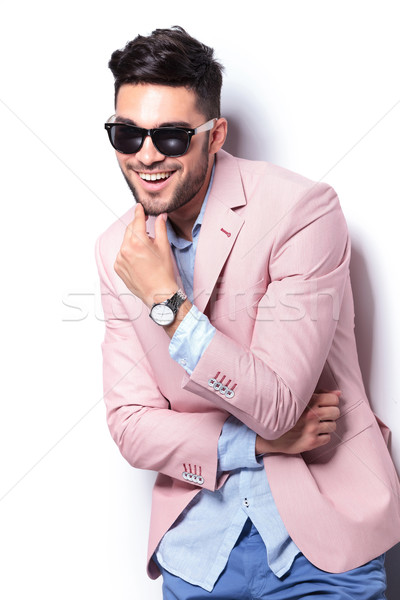 casual man laughing with hand on chin Stock photo © feedough